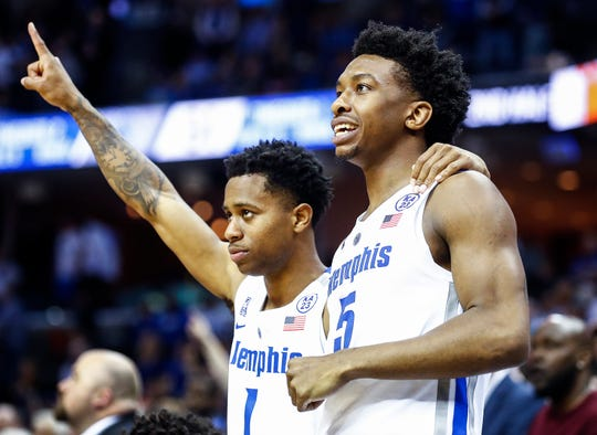 Memphis teammates Tyler Harris (left) and Kareem Brewton Jr. (right) celebrate on the bench during a 66-63 victory over Tulsa at the FedExForum, Saturday, March 9, 2019.