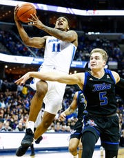 Memphis guard Antwann Jones (left) drives to the basket against Tulsa defender Lawson Korita (right) during action at the FedExForum, Saturday, March 9, 2019.