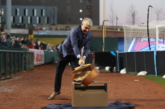 Memphis 901 FC Principal Owner Peter Freund smashes a guitar before they take on theTampa Bay Rowdies at AutoZone Park on Saturday, March 9, 2019.