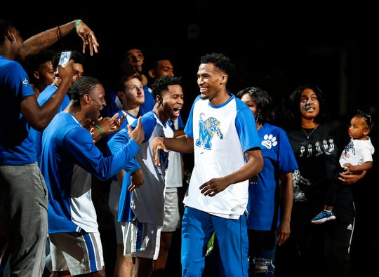 Memphis guard Jeremiah Martin (middle) is greeted by teammates as he is introduced on senior night Saturday before taking on Tulsa at FedExForum.