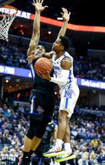 Memphis guard Tyler Harris (right) drives for a layup against Tulsa defender DaQuan Jeffries (left) during action at the FedExForum, Saturday, March 9, 2019.
