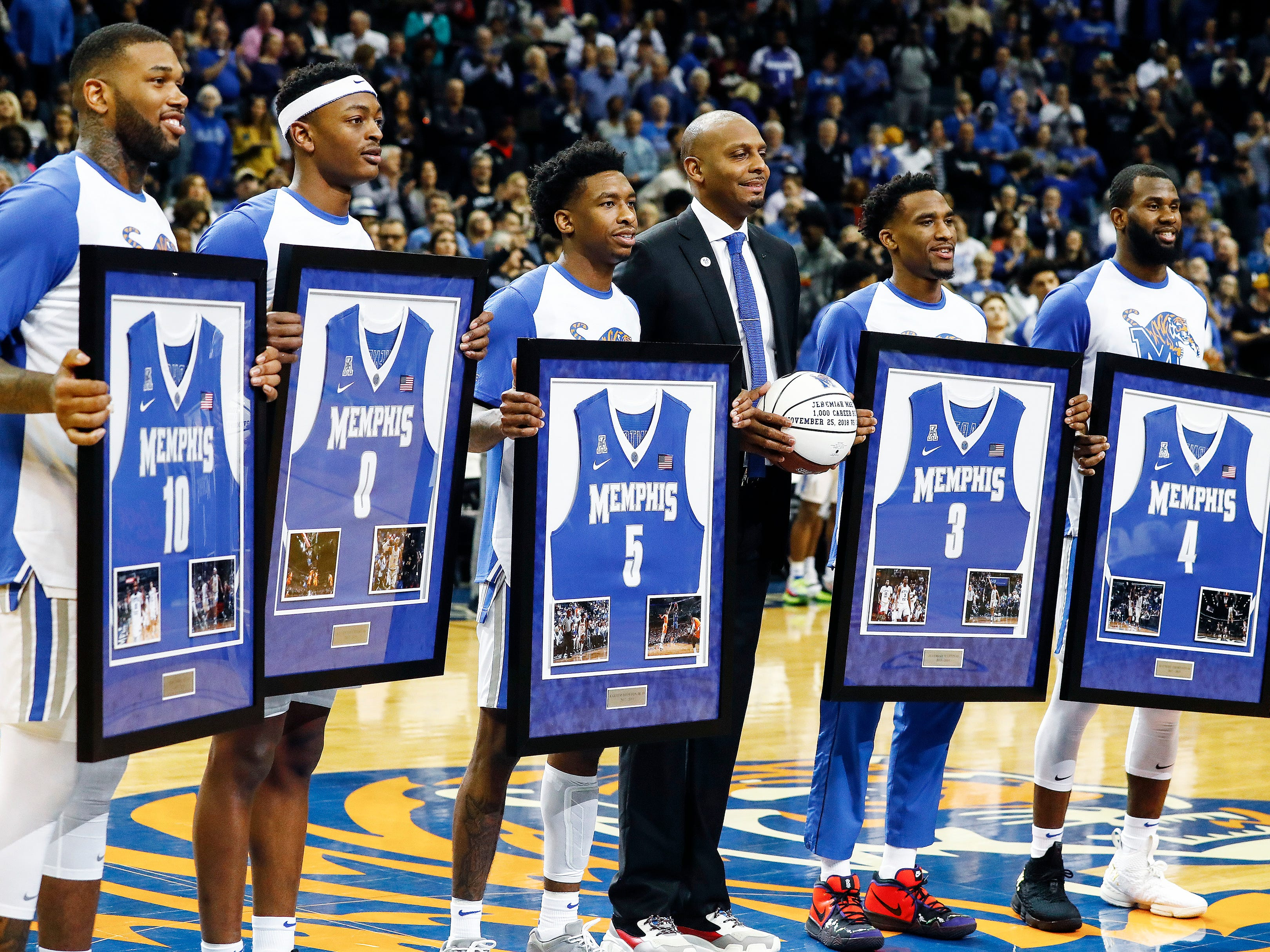 Memphis seniors (left to right) Mike Parks Jr., Kyvon Davenport, Kareem Brewton Jr., Jeremiah Martin and Raynere Thornton are introduced with head coach Penny Hardaway (third right) before taking on Tulsa at the FedExForum, Saturday, March 9, 2019.