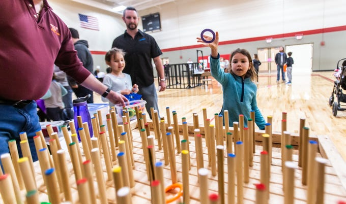 Five-year-old Laikin Guenterberg of Ixonia plays a hoop game during the Winter Carnival at St. Matthew's Lutheran School in Oconomowoc on Saturday, March 9, 2019. The event featured a huge prize booth, games, food, a silent auction and more. Proceeds from the Winter Carnival will be used to purchase non budgeted school items.