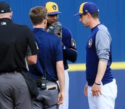 Manager Craig Counsell checks on pitcher Jeremy Jeffress after he threw just three pitches in the Brewers' March 8 exhibition game. Jeffress has was shut down with shoulder weakness.