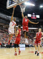 Wisconsin swingman Khalil Iverson comes flying in to block the shot of Ohio State guard C.J. Jackson during the first half Sunday at Value City Arena in Columbus, Ohio.