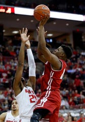 Wisconsin guard Khalil Iverson goes up for a shot against Ohio State forward Andre Wesson during the first half in Columbus, Ohio, on Sunday.