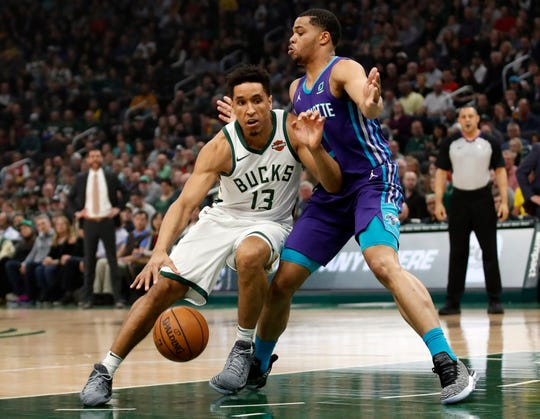 Bucks guard Malcolm Brogdon drives past Hornets forward Miles Bridges  during the first half.