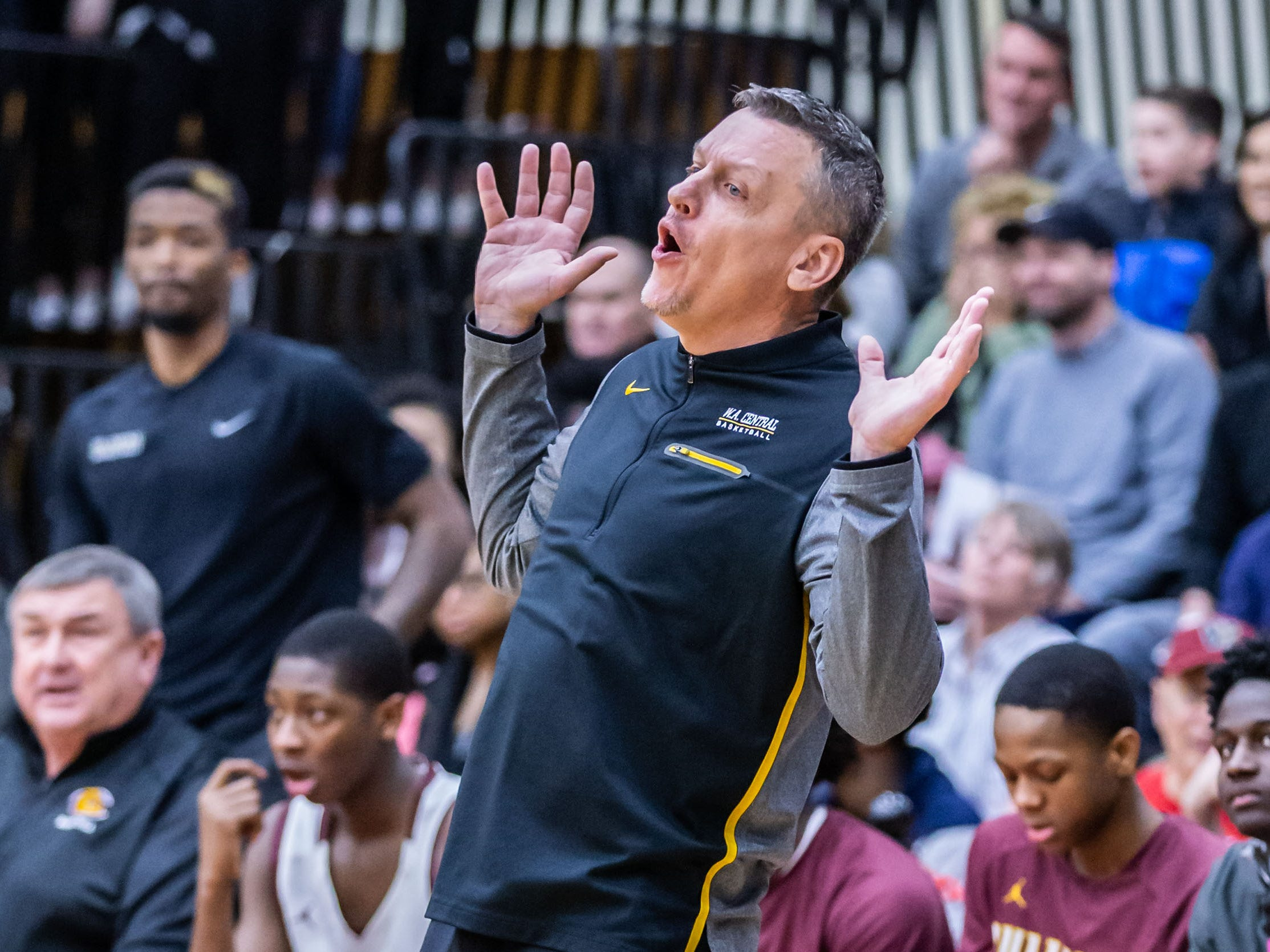 West Allis Central head coach David Mlachnik reacts to a call during the sectional final against Waukesha West at Waukesha South on Saturday, March 9, 2019.
