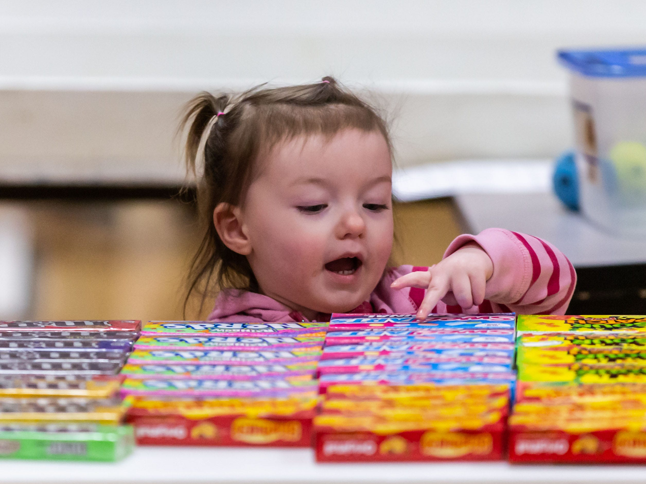 Two-year-old Emma Cina of Mayville chooses a candy prize during the Winter Carnival at St. Matthew's Lutheran School in Oconomowoc on Saturday, March 9, 2019. The event featured a huge prize booth, games, food, a silent auction and more. Proceeds from the Winter Carnival will be used to purchase non budgeted school items.