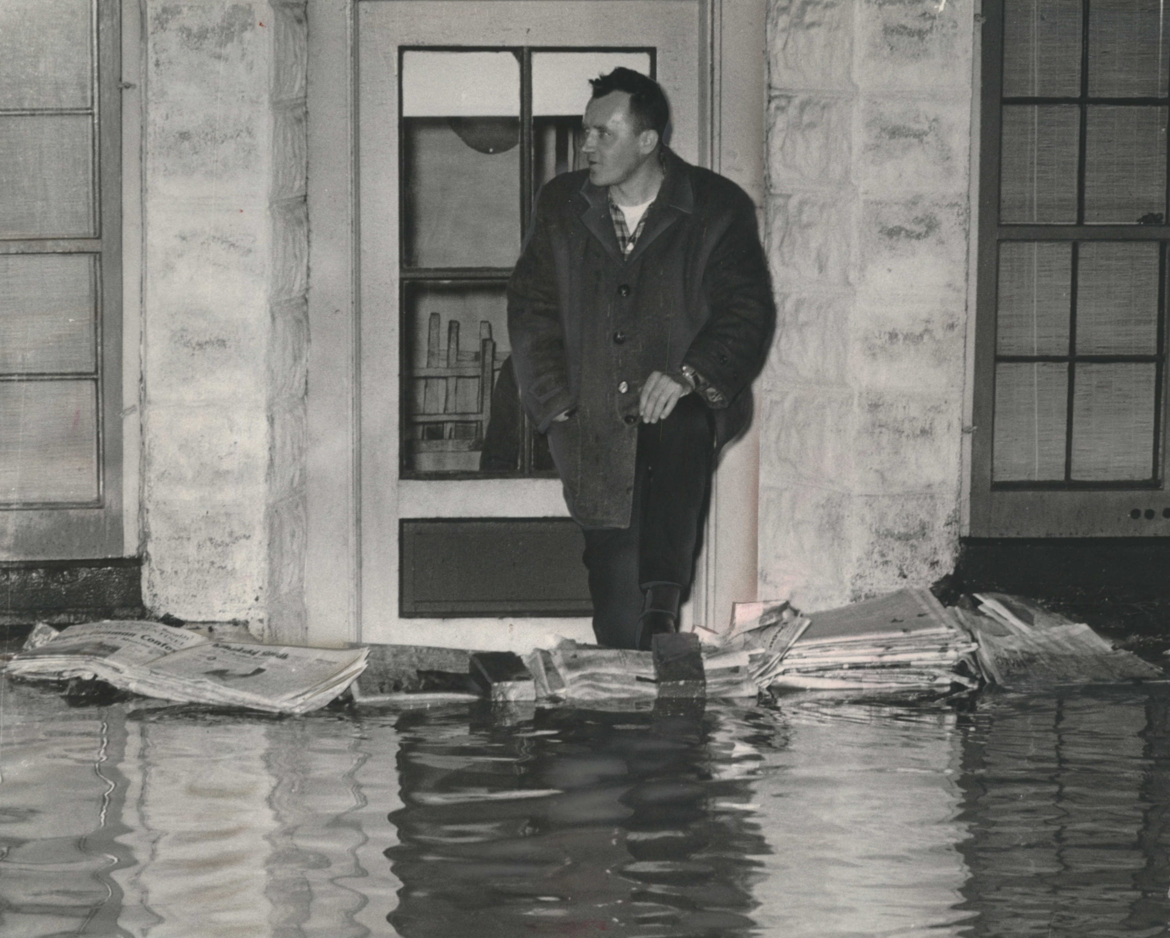Stacks of newspapers, weighted by bricks, form a makeshift dam at the door of basement apartment in the 500 block of North 41st Street on March 29, 1960. This photo was published in the March 30, 1960, Milwaukee Journal.