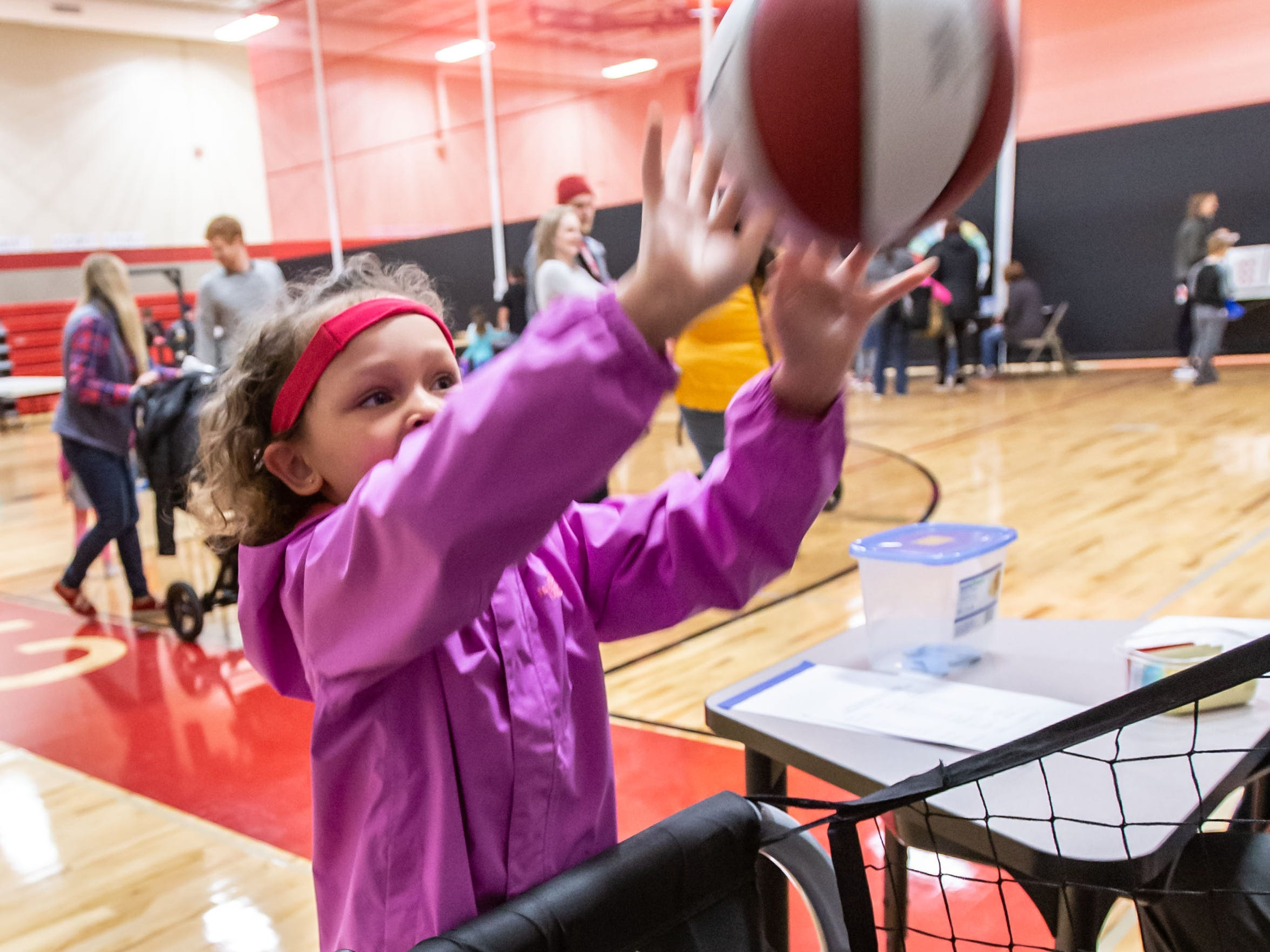 Five-year-old Kallie Mason of Watertown plays a basketball game during the Winter Carnival at St. Matthew's Lutheran School in Oconomowoc on Saturday, March 9, 2019. The event featured a huge prize booth, games, food, a silent auction and more. Proceeds from the Winter Carnival will be used to purchase non budgeted school items.