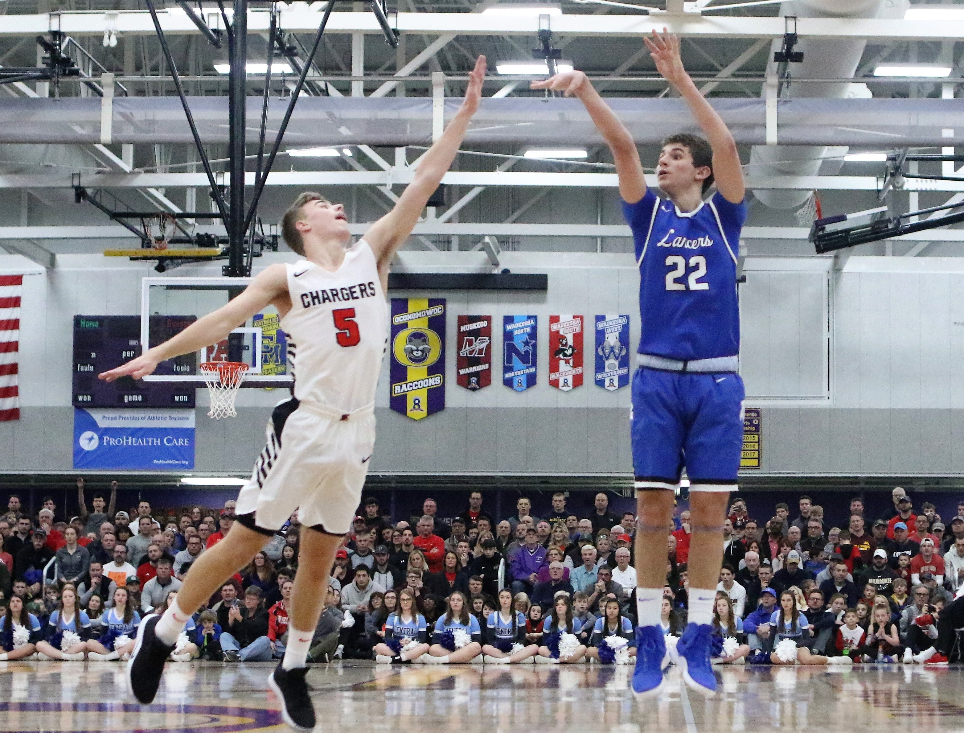 Brookfield Central guard Ben Nau fires a three-pointer over Sussex Hamilton guard Carson Smith during a WIAA sectional final on March 9, 2019.
