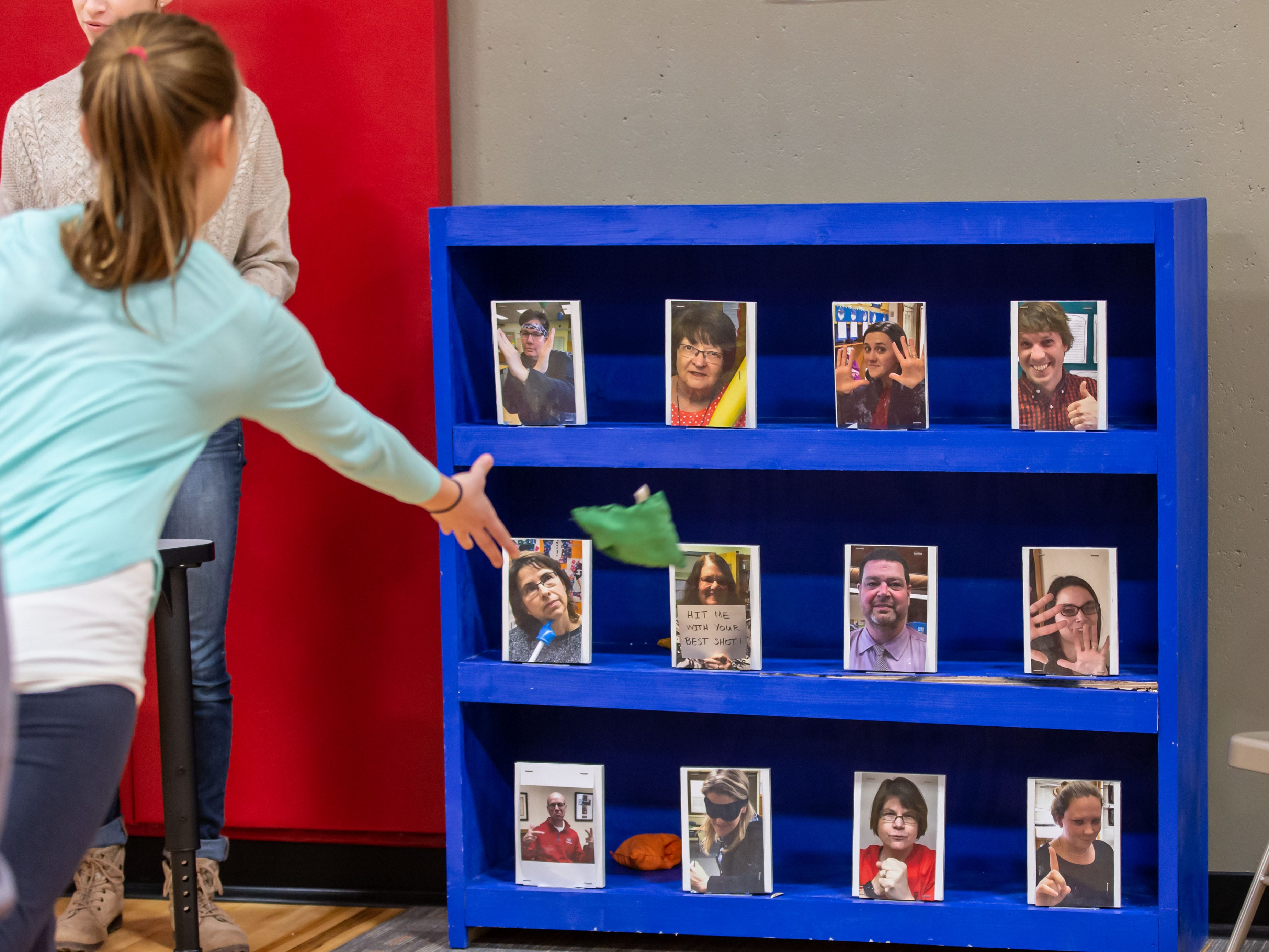 Attendees take aim on teacher's pictures during the Winter Carnival at St. Matthew's Lutheran School in Oconomowoc on Saturday, March 9, 2019. The event featured a huge prize booth, games, food, a silent auction and more. Proceeds from the Winter Carnival will be used to purchase non budgeted school items.