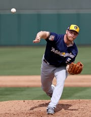 Brandon Woodruff, who's battling for a spot in the Brewers' starting rotation, pitched three strong innings against the Athletics on Saturday, giving up just one hit and a walk while striking out five.