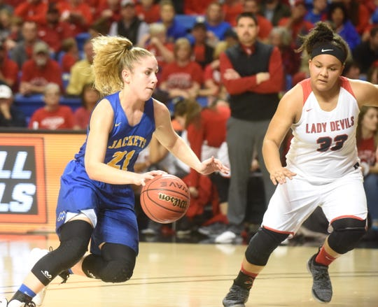 Mountain View's Aubrey Isbell brings the ball upcourt during her team's win over Atkins in the Class 3A State championship game.