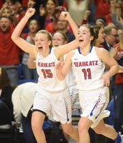 Melbourne's Kylee Humphries and Reagan Rapert storm the court after winning the Class 2A State championship on Saturday in Hot Springs.