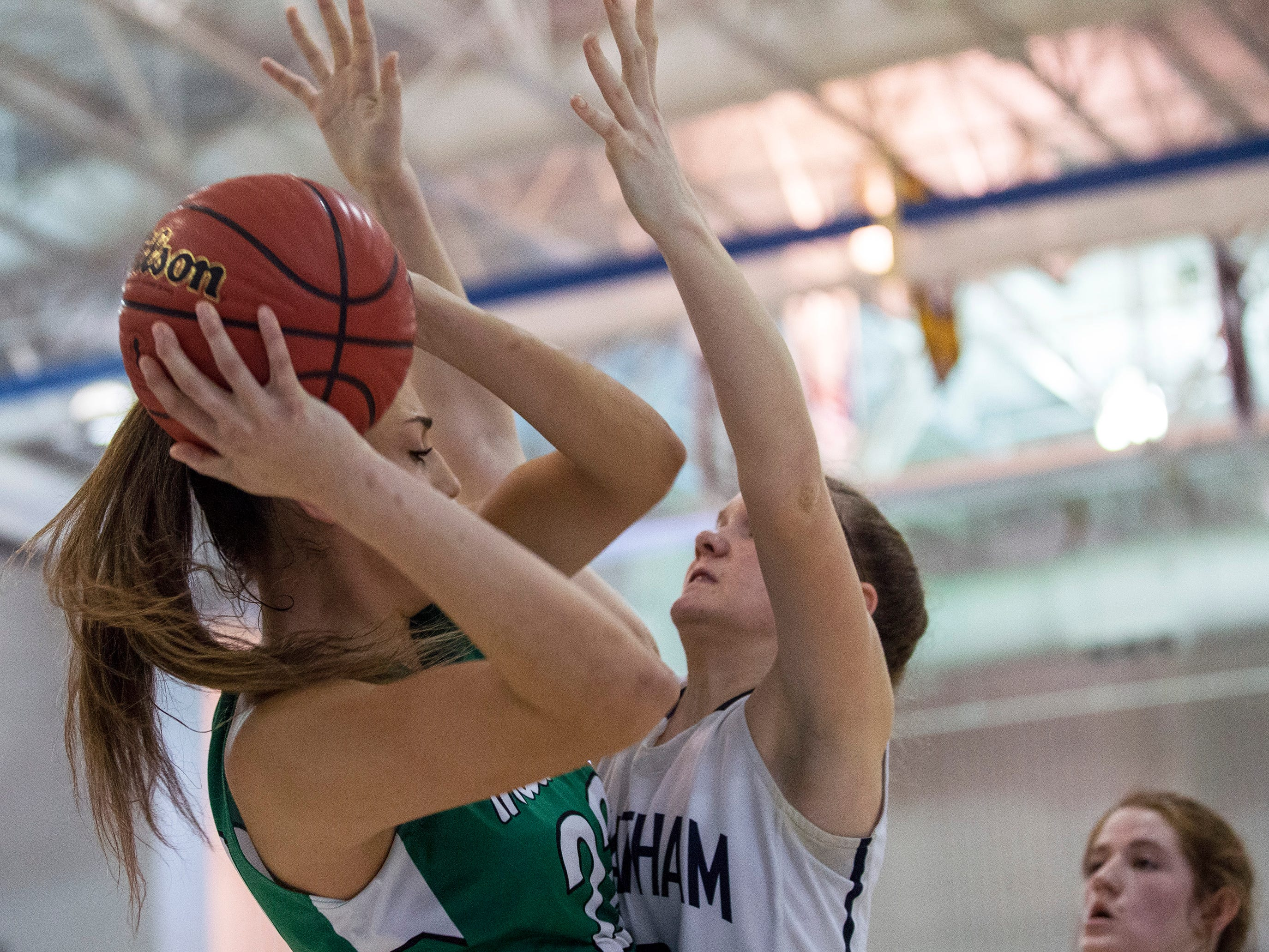 Carly Frohnapfel works hard to guard Kylee Watson, Mainland, during second half action. Chatham Girls Basketball vs Mainland in Girls Group III Final in Toms River on March 10, 2019.