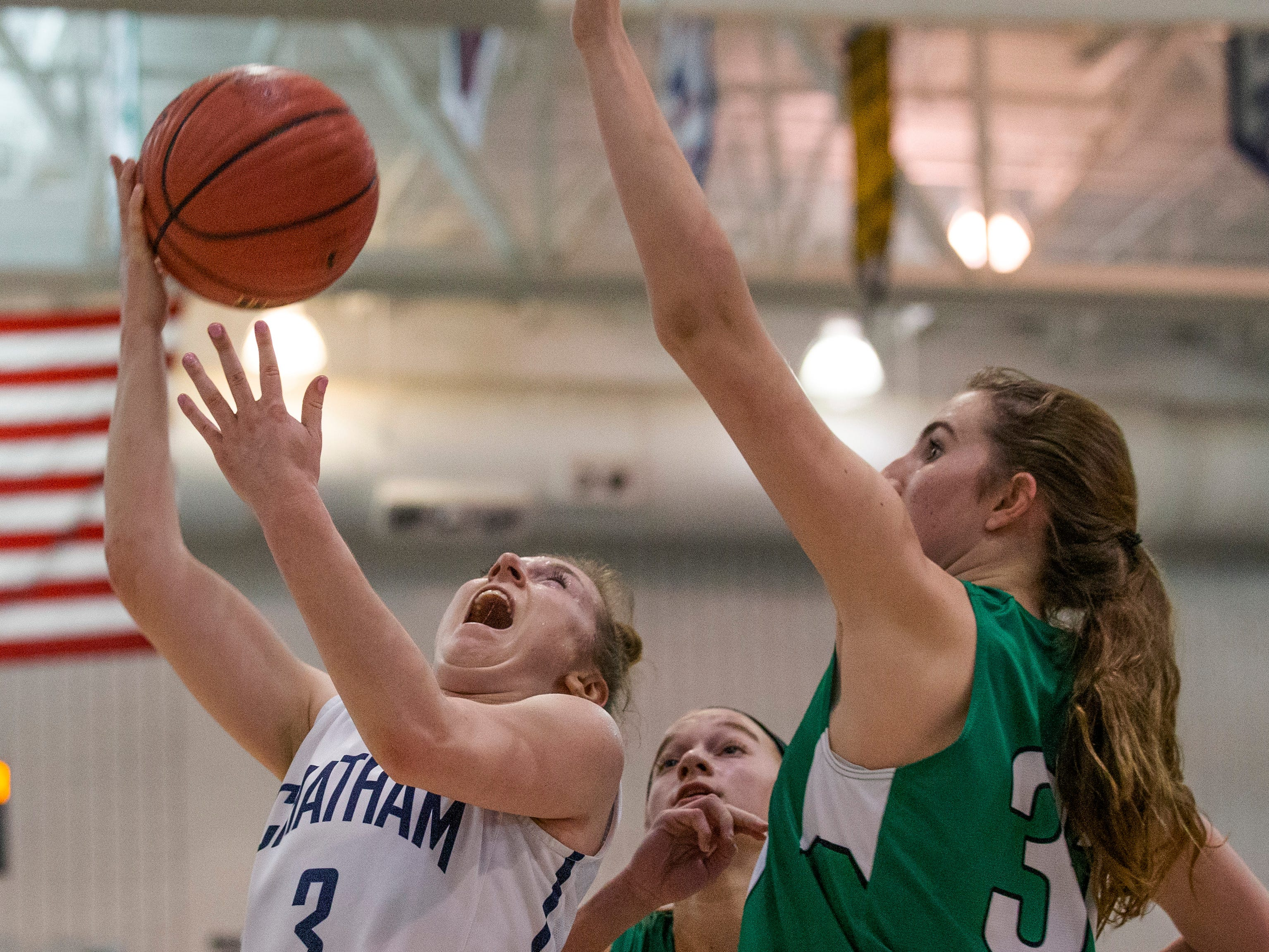 Michaela Ford puts up a shot as Mainland's Kaitlyn Boggs tries to block her. Chatham Girls Basketball vs Mainland in Girls Group III Final in Toms River on March 10, 2019.