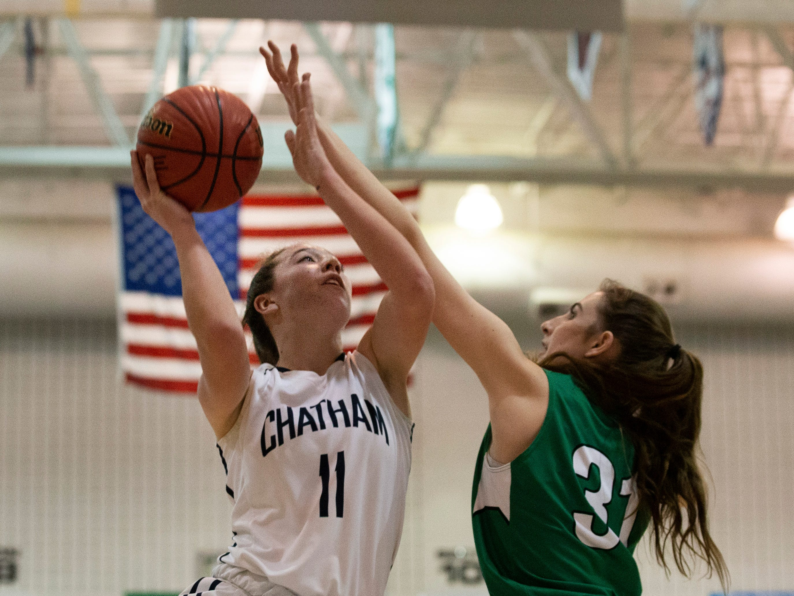 Shannon Donohoe, Chatham, goes up with shot against Kaitlyn Boggs, Mainland, during first half action. Chatham Girls Basketball vs Mainland in Girls Group III Final in Toms River on March 10, 2019.