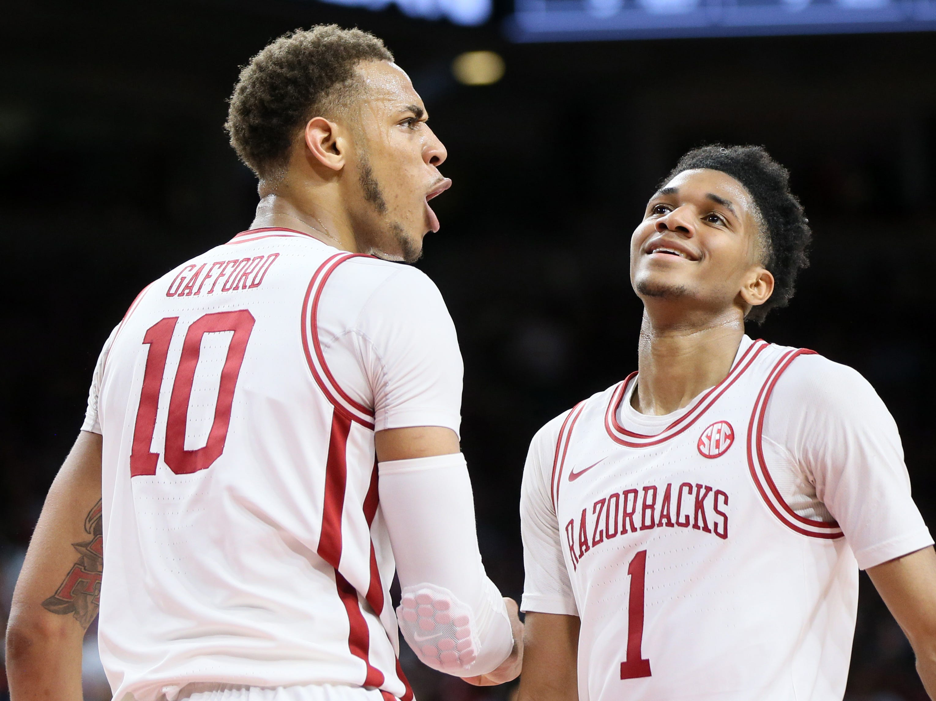 Mar 9, 2019; Fayetteville, AR, USA; Arkansas Razorbacks forward Daniel Gafford (10) reacts after being called for a foul as guard Isaiah Joe (1) looks on during the first half against the Alabama Crimson Tide at Bud Walton Arena. Mandatory Credit: Nelson Chenault-USA TODAY Sports