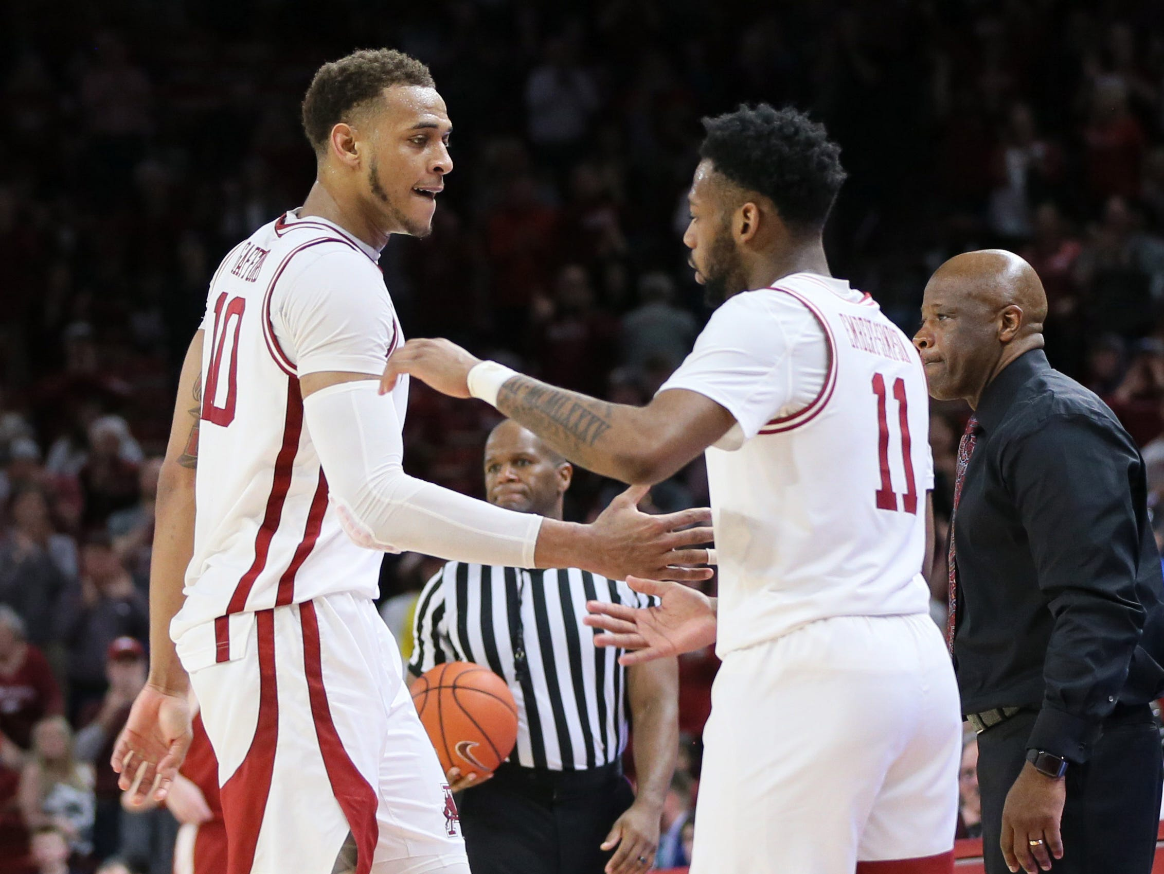 Mar 9, 2019; Fayetteville, AR, USA; Arkansas Razorbacks forward Daniel Gafford (10) celebrates with guard Keyshawn Embery Simpson (11) as Gafford leaves the court in the final minutes of the game against the Alabama Crimson Tide at Bud Walton Arena. Arkansas won 82-70. Mandatory Credit: Nelson Chenault-USA TODAY Sports