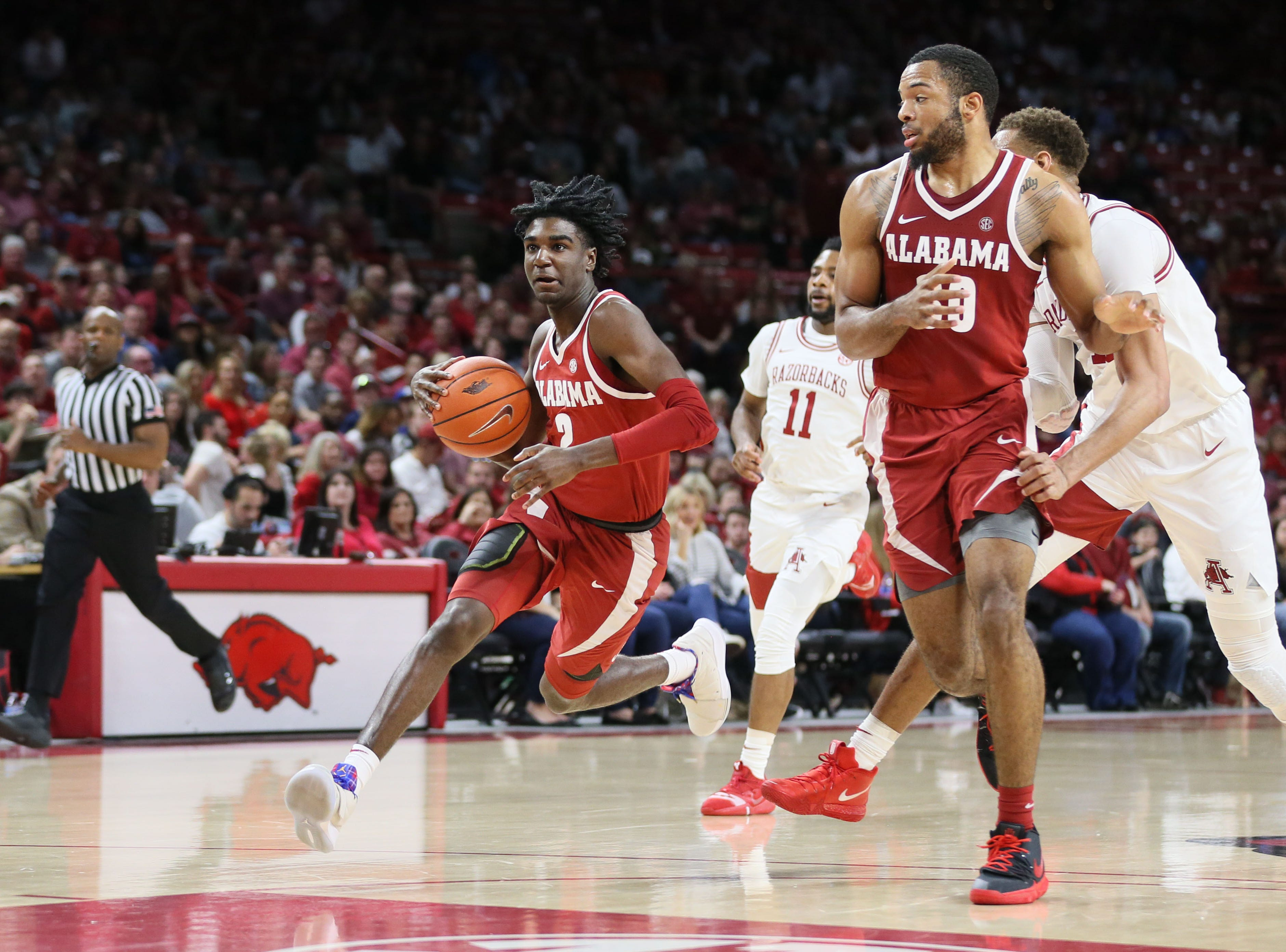 Mar 9, 2019; Fayetteville, AR, USA; Alabama Crimson Tide guard Kira Lewis Jr (2) drives to the basket as forward Galin Smith (30) screens during the first half against the Arkansas Razorbacks at Bud Walton Arena. Mandatory Credit: Nelson Chenault-USA TODAY Sports