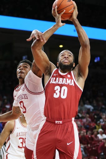 Mar 9, 2019; Fayetteville, AR, USA; Alabama Crimson Tide forward Galin Smith (30) is fouled while shooting by Arkansas Razorbacks guard Desi Sills (0) at Bud Walton Arena. Mandatory Credit: Nelson Chenault-USA TODAY Sports