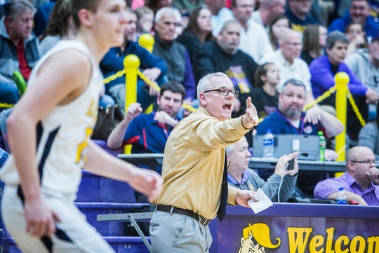Delta coach Mark Detweiler, shown here during the regional game against Marion, led the Eagles to the only perfect regular season in the state.