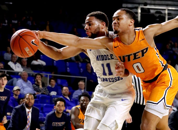 MTSU guard Lawrence Mosley (11) and UTEP guard Nigel Hawkins (0) both go after a loose ball on Saturday, March 9, 2019, at Murphy Center in Murfreesboro, Tenn.