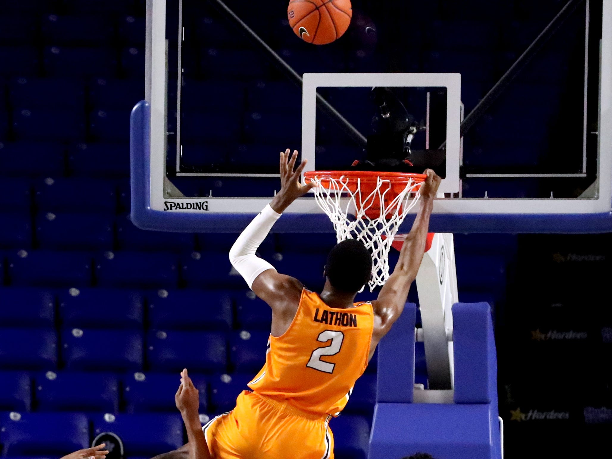 UTEP guard Jordan Lathon (2) holds onto the rim to make his ball go into the net on Saturday against MTSU, March 9, 2019, at Murphy Center in Murfreesboro, Tenn.