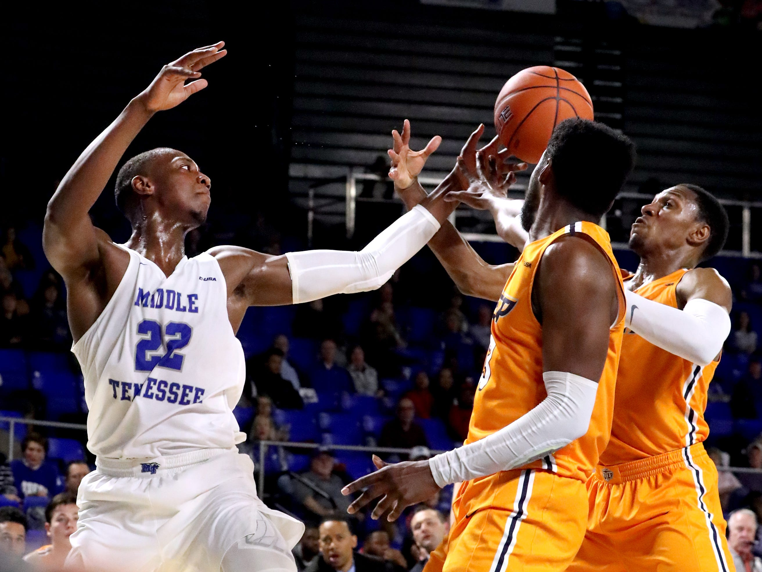MTSU forward Reggie Scurry (22) UTEP guard Ountae Campbell (13) and UTEP guard Evan Gilyard (3) all go for a loos ball on Saturday, March 9, 2019, at Murphy Center in Murfreesboro, Tenn.
