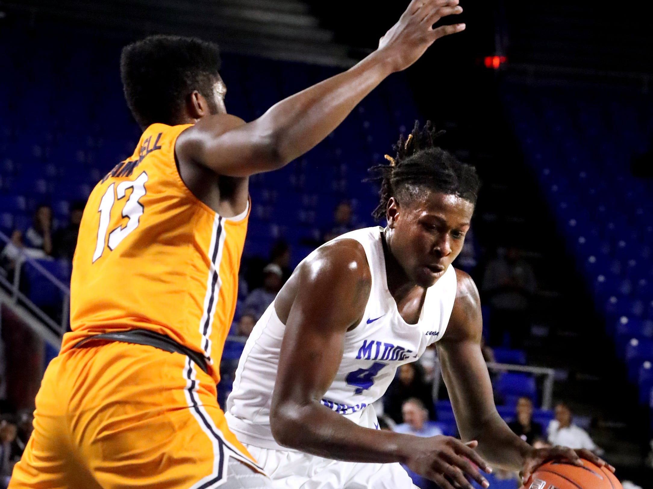 MTSU forward James Hawthorne (4) drives to the basket as UTEP guard Ountae Campbell (13) guards him on Saturday, March 9, 2019, at Murphy Center in Murfreesboro, Tenn.
