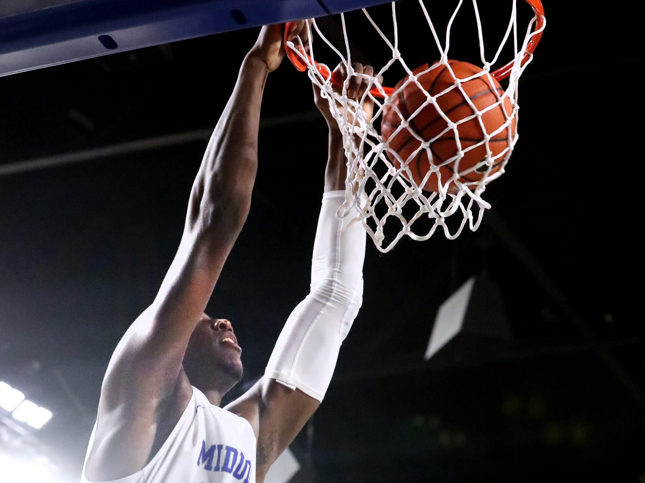 MTSU forward Reggie Scurry (22) dunks the ball on Saturday against UTEP, March 9, 2019, at Murphy Center in Murfreesboro, Tenn.
