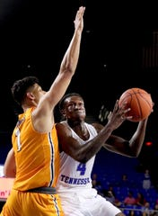 MTSU forward James Hawthorne (4) drives to the basket as UTEP forward Paul Thomas (1) guards him on Saturday, March 9, 2019, at Murphy Center in Murfreesboro, Tenn.