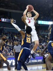 Belmont's Dylan Windler shoots over Murray State's Ja Morant in Saturday's OVC championship game at the Ford Center in Evansville, Ind.