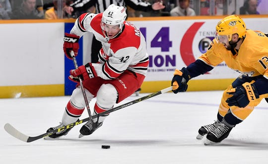 Predators center Nick Bonino (13) tries to take the puck from Hurricanes center Greg McKegg (42) during the second period at Bridgestone Arena Saturday, March 9, 2019 in Nashville, Tenn.