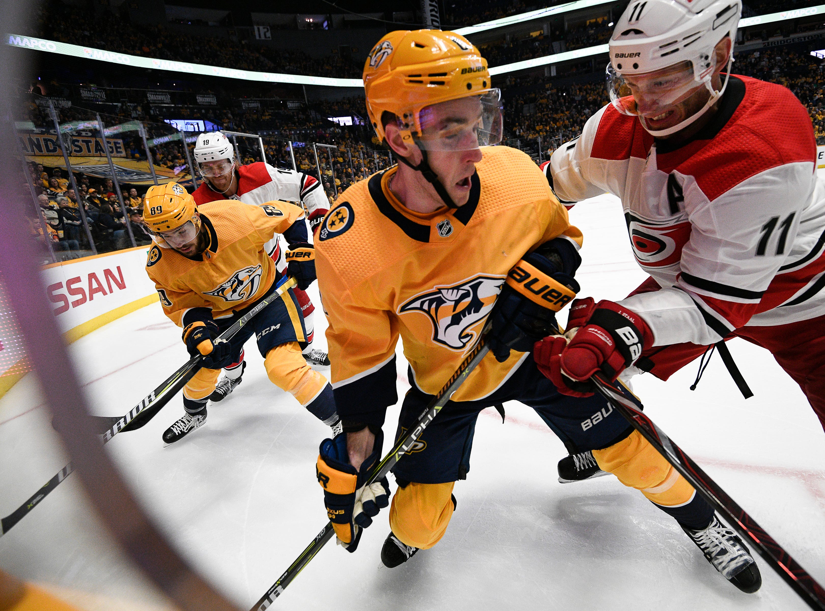 Predators center Kyle Turris (8) battles Hurricanes center Jordan Staal (11) for the puck during the third period at Bridgestone Arena Saturday, March 9, 2019 in Nashville, Tenn.