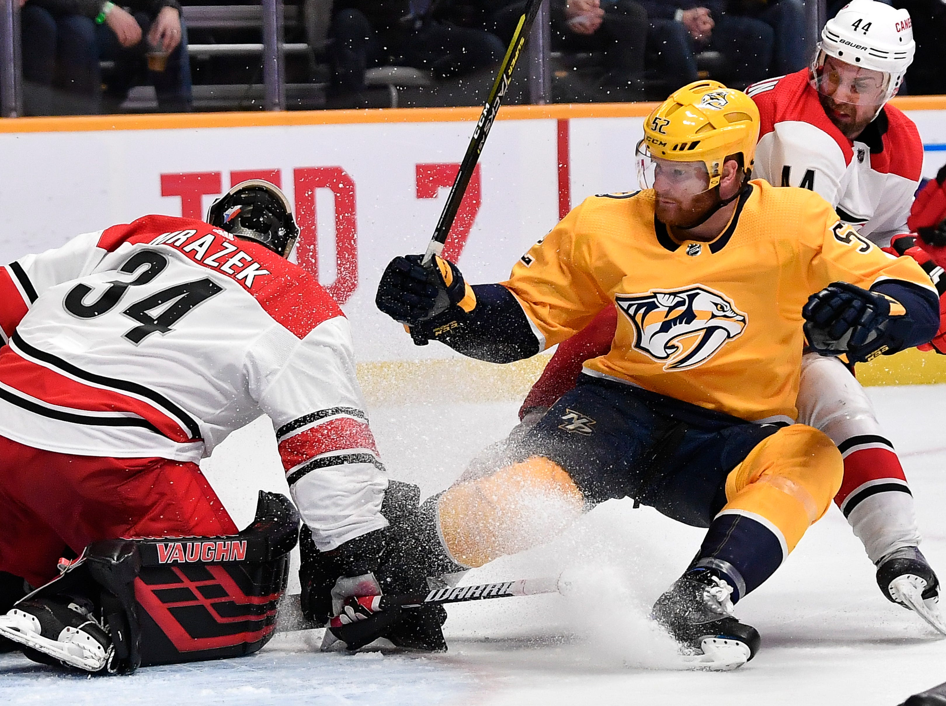 Mar. 9, 2019 Predators 3 Hurricanes 5:  Predators defenseman Matt Irwin (52) slides into Hurricanes goaltender Petr Mrazek (34) as he attacks the goal during the third period at Bridgestone Arena Saturday, March 9, 2019 in Nashville, Tenn.