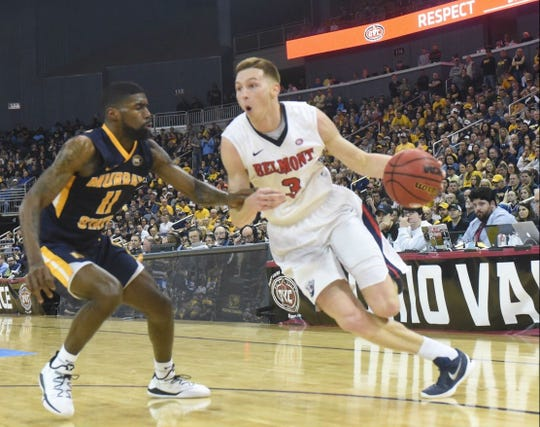 Belmont's Dylan Windler (3) drives against Murray State's Shaq Buchanan in the OVC tournament championship game.