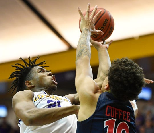 Lipscomb guard Kenny Cooper (21) goes up for a shot Sunday.