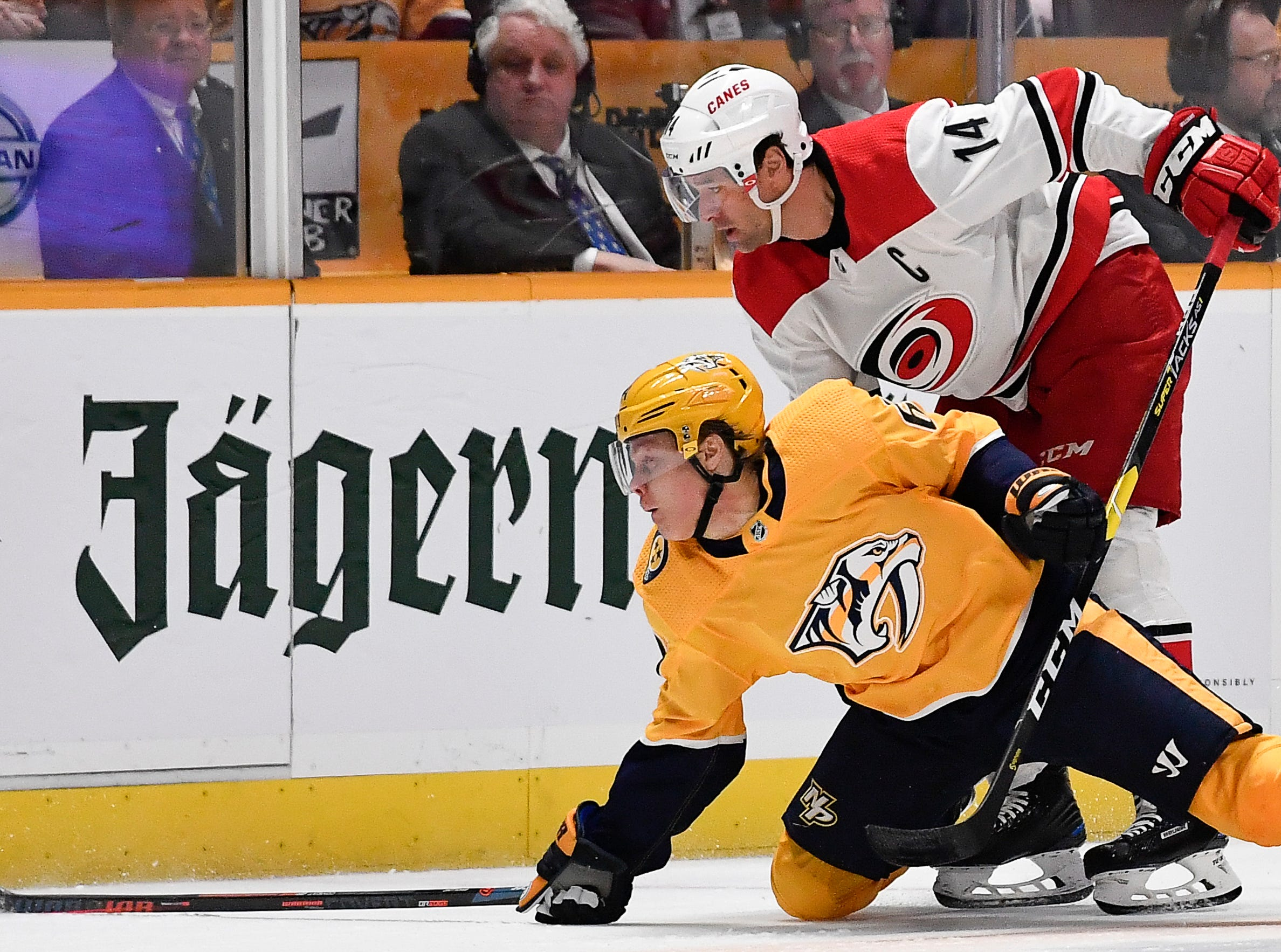 Predators center Mikael Granlund (64) fights Hurricanes right wing Justin Williams (14) for the puck during the first period at Bridgestone Arena Saturday, March 9, 2019 in Nashville, Tenn.