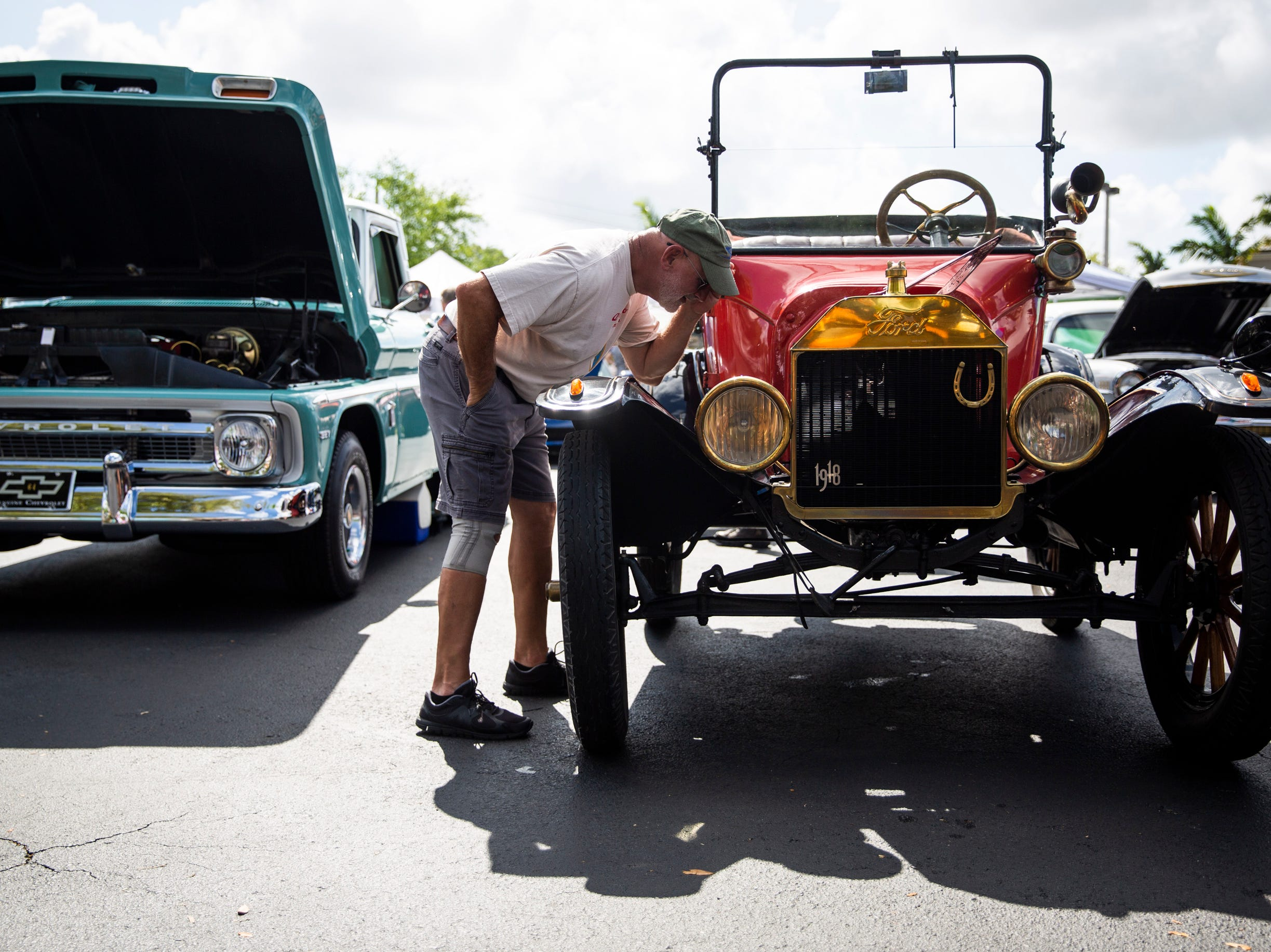 Dave Crowley looks at a 1918 Ford Model T during the West Coast Muscle Car Club's 15th annual car and truck show at the Galleria Shoppes at Vanderbilt in Naples on Sunday, March 10, 2019. Crowley says that he likes this show better than Cars on 5th because it's less crowded and has more variety.