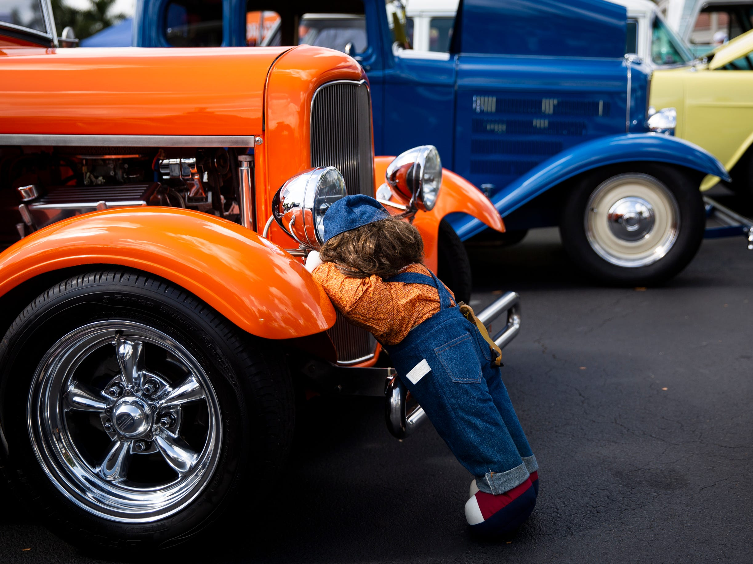 A plush mechanic leans on the front end of 1930 Ford Model A during the West Coast Muscle Car Club's 15th annual car and truck show at the Galleria Shoppes at Vanderbilt in North Naples on Sunday, March 10, 2019.