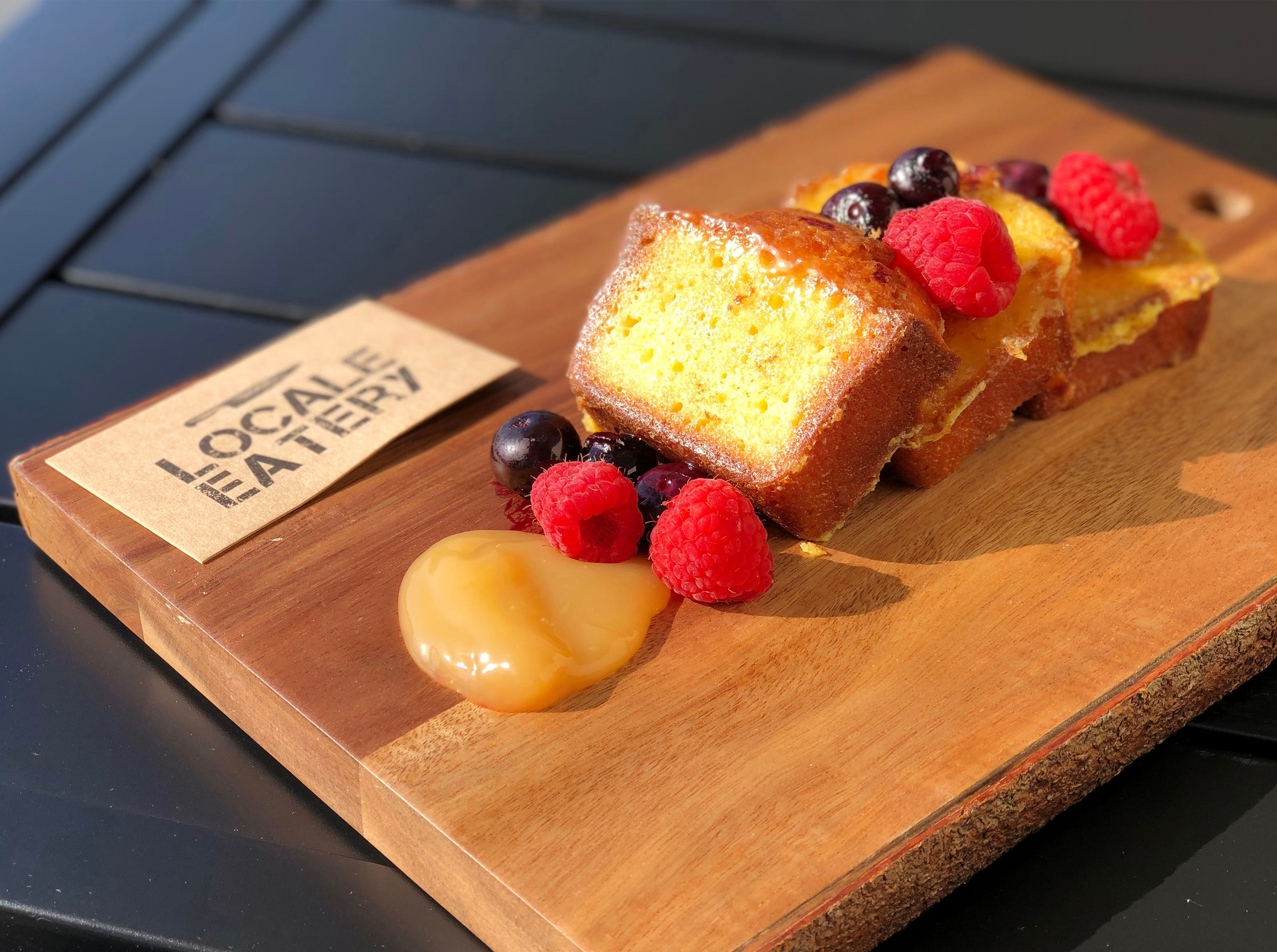 Eatery French Toast features house-made pound cake with lemon curd and berries at Locale Eatery in North Naples.