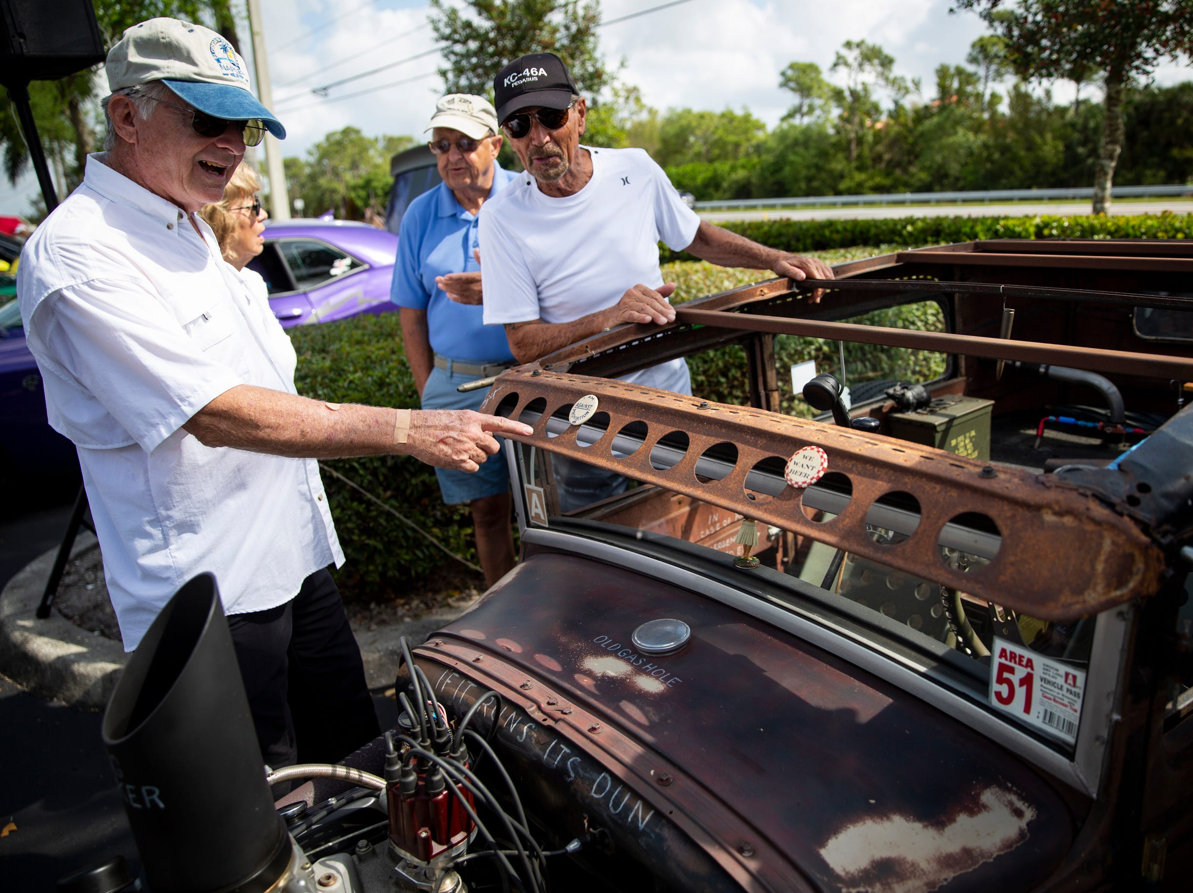 Roger Rose, left, talks to Barry Grothause, right, about his 1931 Ford Rat Rod during the West Coast Muscle Car Club's 15th annual car and truck show at the Galleria Shoppes at Vanderbilt in North Naples on Sunday, March 10, 2019.