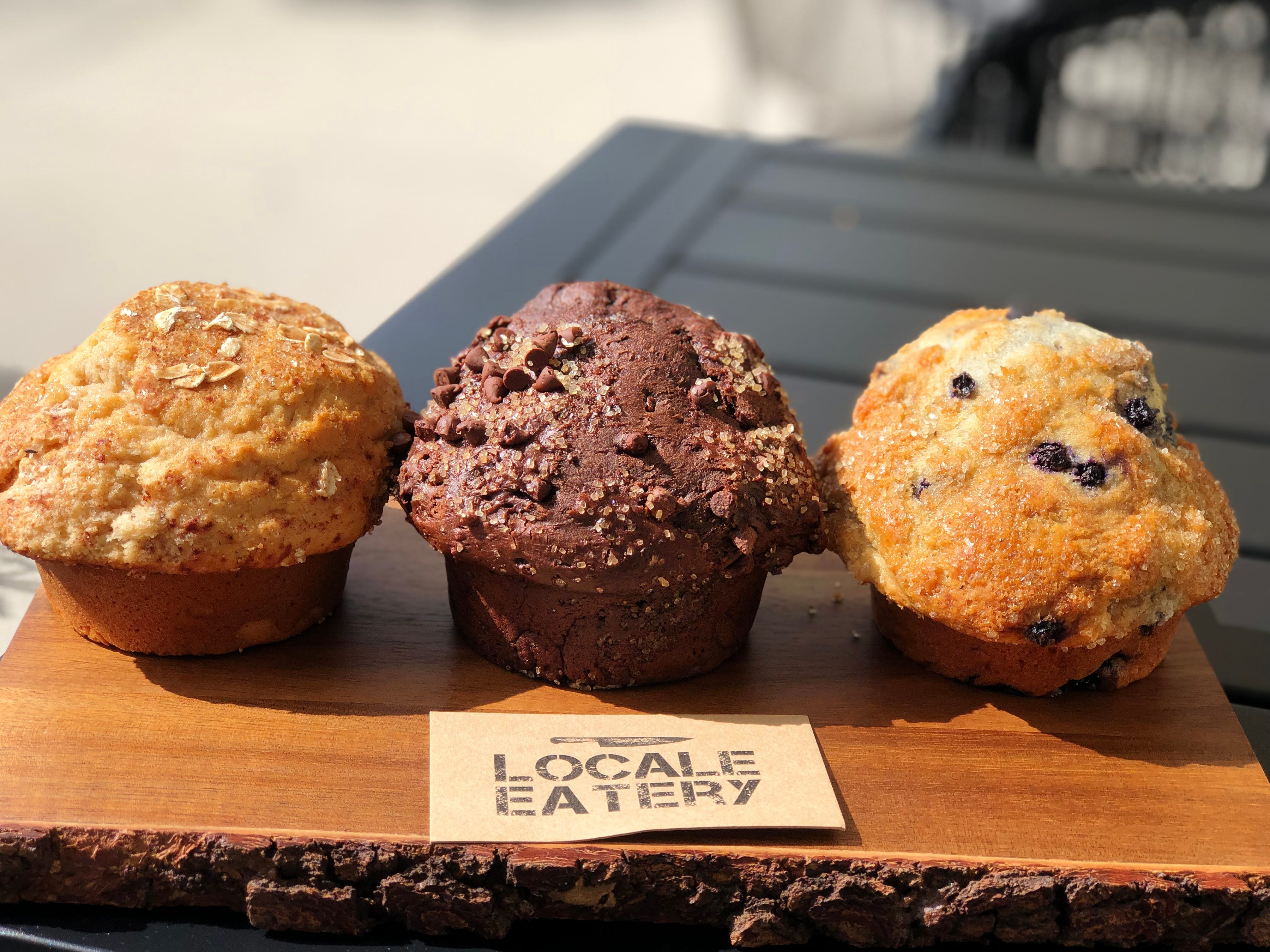 Apple cinnamon oatmeal, double chocolate and blueberry muffins made fresh at Locale Eatery in North Naples.