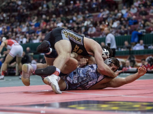 Northmor's Conor Becker completely dominated Ashtabula St. John's David Cumberledge, winning a state title with a second period pin to avenge a loss in the first round of the 2018 tournament.