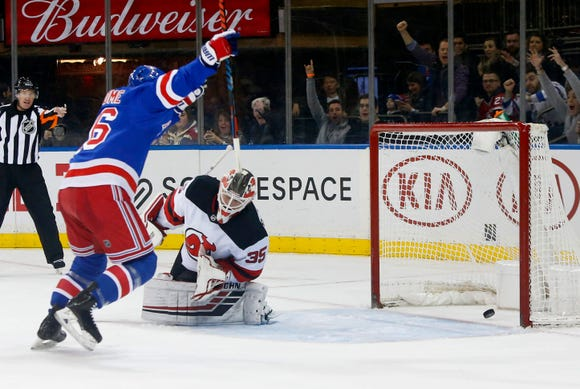 Mar 9, 2019; New York, NY, USA;  New York Rangers center Ryan Strome (16) celebrates after scoring a goal against New Jersey Devils goaltender Cory Schneider (35) during the second period at Madison Square Garden.