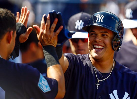 Mar 10, 2019; Tampa, FL, USA; New York Yankees third baseman Gio Urshela (70) celebrates with teammates after hitting a home run during the fifth inning against the Pittsburgh Pirates at George M. Steinbrenner Field.