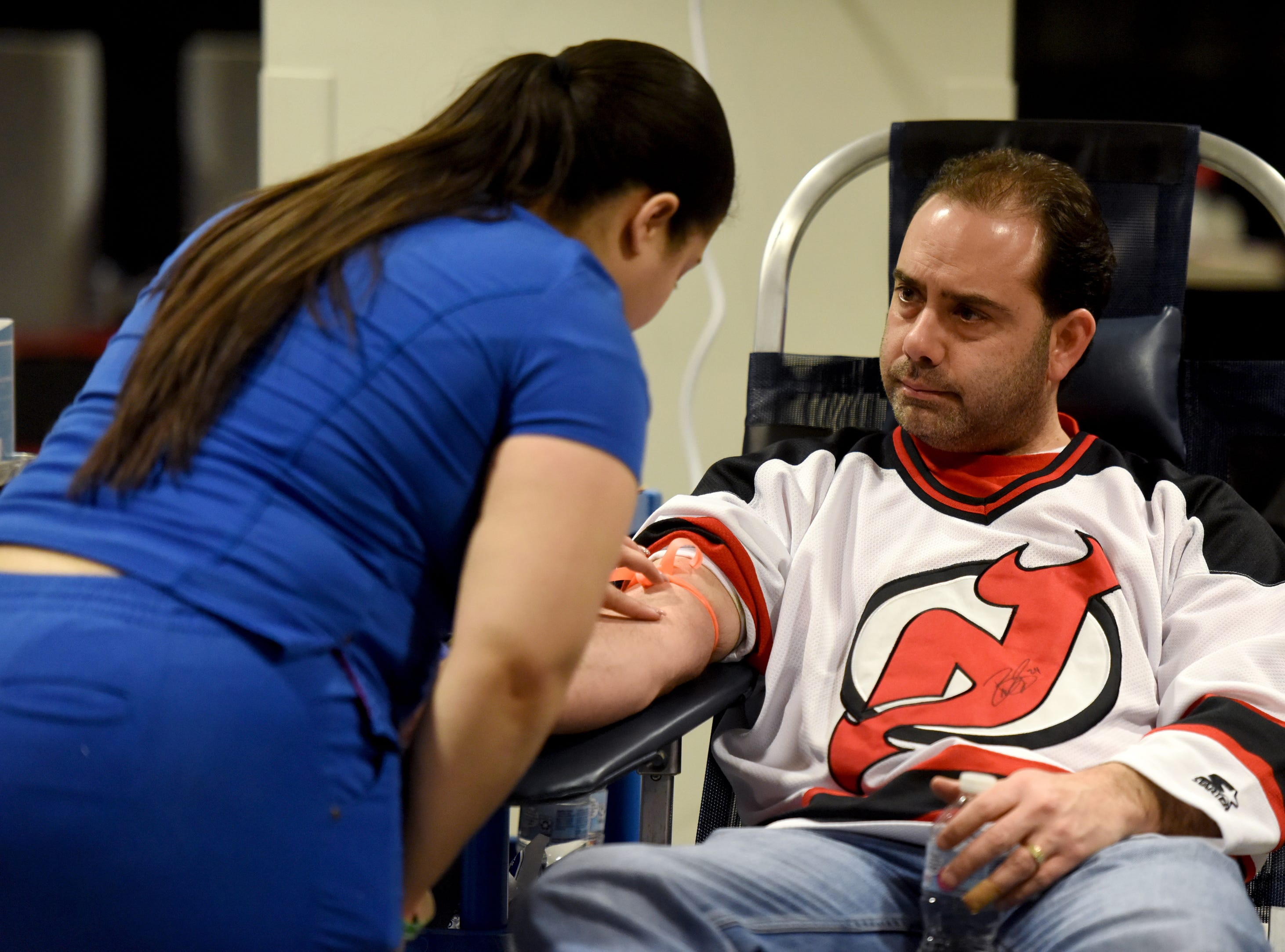 The New Jersey Devils and RWJBarnabas Health hosted their third annual blood drive in coordination with the American Red Cross on Sunday, March 10, 2019 at the Prudential Center in Newark. Blood donor Jason Caracciolo watches apheresis tech Danellis Diaz look for a vein.